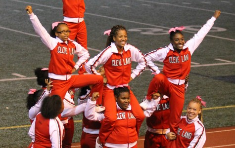 The cheerleading squard finishes their performance with a pyramid during halftime at a football game against West Seattle. The girls are on the sidelines at every game, rain or shine.