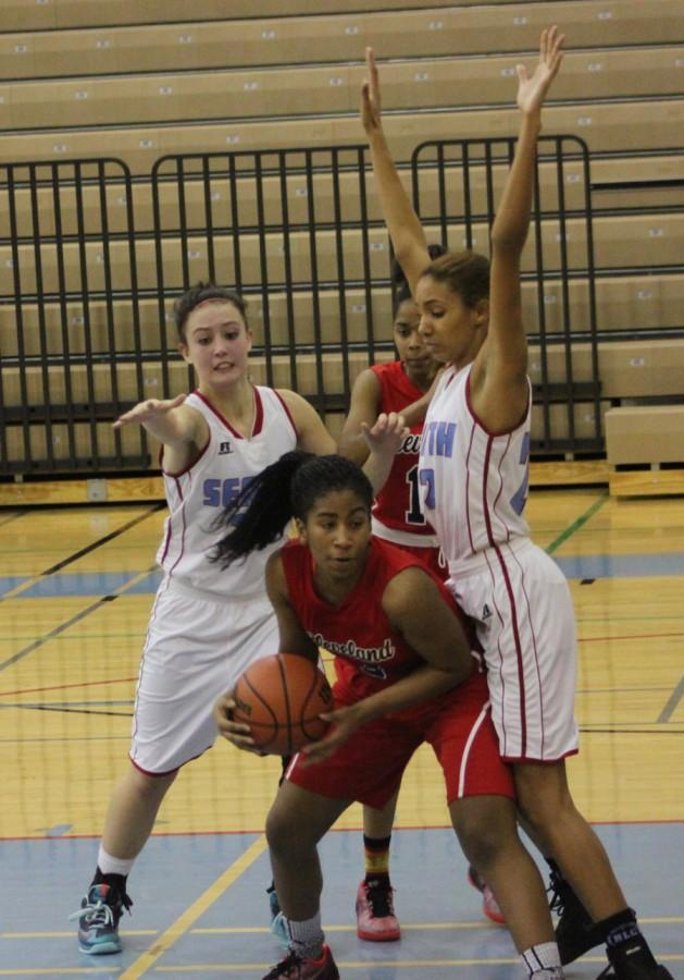 Junior shooting guard Teja Kirby goes around a Chief Sealth defender on Dec. 10. Kirby has been a standout this season for the Lady Eagles, earning All-Metro Honorable Mention.
