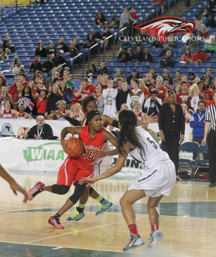 Senior point guard Jayde Christopher drives to the basket in the Lady Eagles match up against Wilson in the first round of the State Tournament on Thursday, March 5, at the Tacoma Dome.