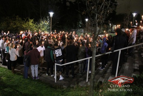 Hundreds attended a candlelight vigil for Cleveland senior Robert Robinson, who died in a drive by shooting on March 15.