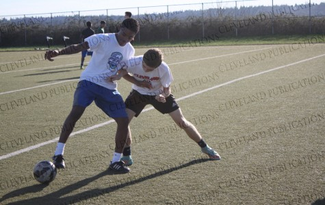 Sophomore Lucas King, right, fights for the ball with Freshman Omar Grey during soccer practice on March 6.