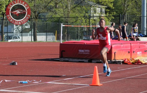 Freshman Isaac Robersone goes through a practice run before attempting the triple jump on April 9 at Nathan Hale.