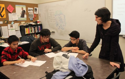 Language Arts teacher Laura Blackburn, right, goes over a lesson with her sophomore students.