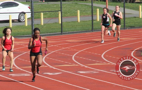 Sophomore Gianna Kelly hands off the baton to Shai'Ree Walker during a race at Rainer Beach on April 1.
