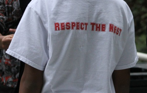 """A freshman wears their """"Respect the Nest"""" shirt. Every grade has a different color. The shirts were designed by junior Lucas King."""
