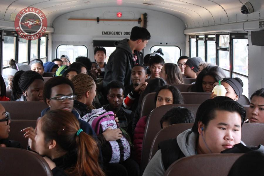 Students+who+ride+Bus+404+are+forced+to+sit+or+stand+in+the+aisle+because+of+overcrowding.+According+to+district+rules%2C+high+school+students+are+only+allowed+two+to+a+seat.