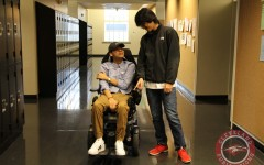 Seniors Phong Ton, left, and Sang Tran have developed a tight bond since Ton was left paralyzed in May.