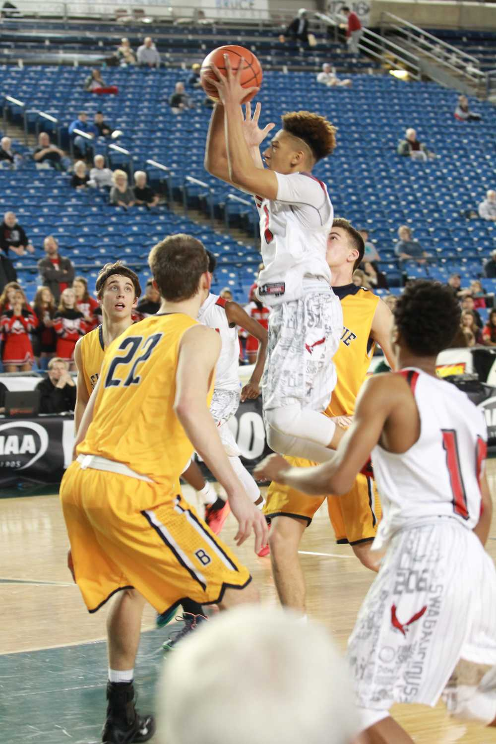 Davon Bolton goes up against a pack of Wolverines during the 3A State Tournament game against Bellevue. The Eagles came up short but finished in sixth place.