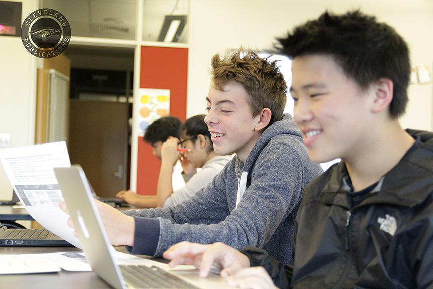 Freshman Anthony Ginsberg, center, works on a PowerPoint presentation in David Roark's Physical Science class on Oct. 27. Ginsberg is one of 60 white students out of the 860 enrolled at Cleveland. White students make up less that 7 percent of the school's population.