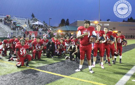 Cleveland football players take a knee during the National Anthem before the start of the Homecoming game against Chief Sealth on Oct. 14, 2016.