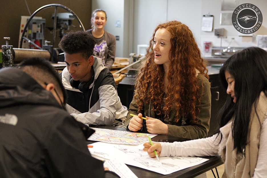 Sophomore Madison O'Brien chats with her classmates as she works on an art project on Oct. 27. O'Brien transferred from Issaquah High School where the population was considerably more white.