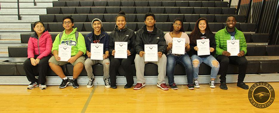 These eight students represent the quality of Unity from the school's motto, Spirit Unity Progress.