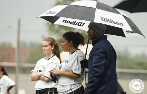Girls soccer co-captains Sibleigh Julander, left, and Shaylah Fernandez watch from the sidelines with assistant coach Kevin Wells on Sept. 19. The team has struggled for several seasons, from sharing uniforms with the boys team to not having a winning season in six years.