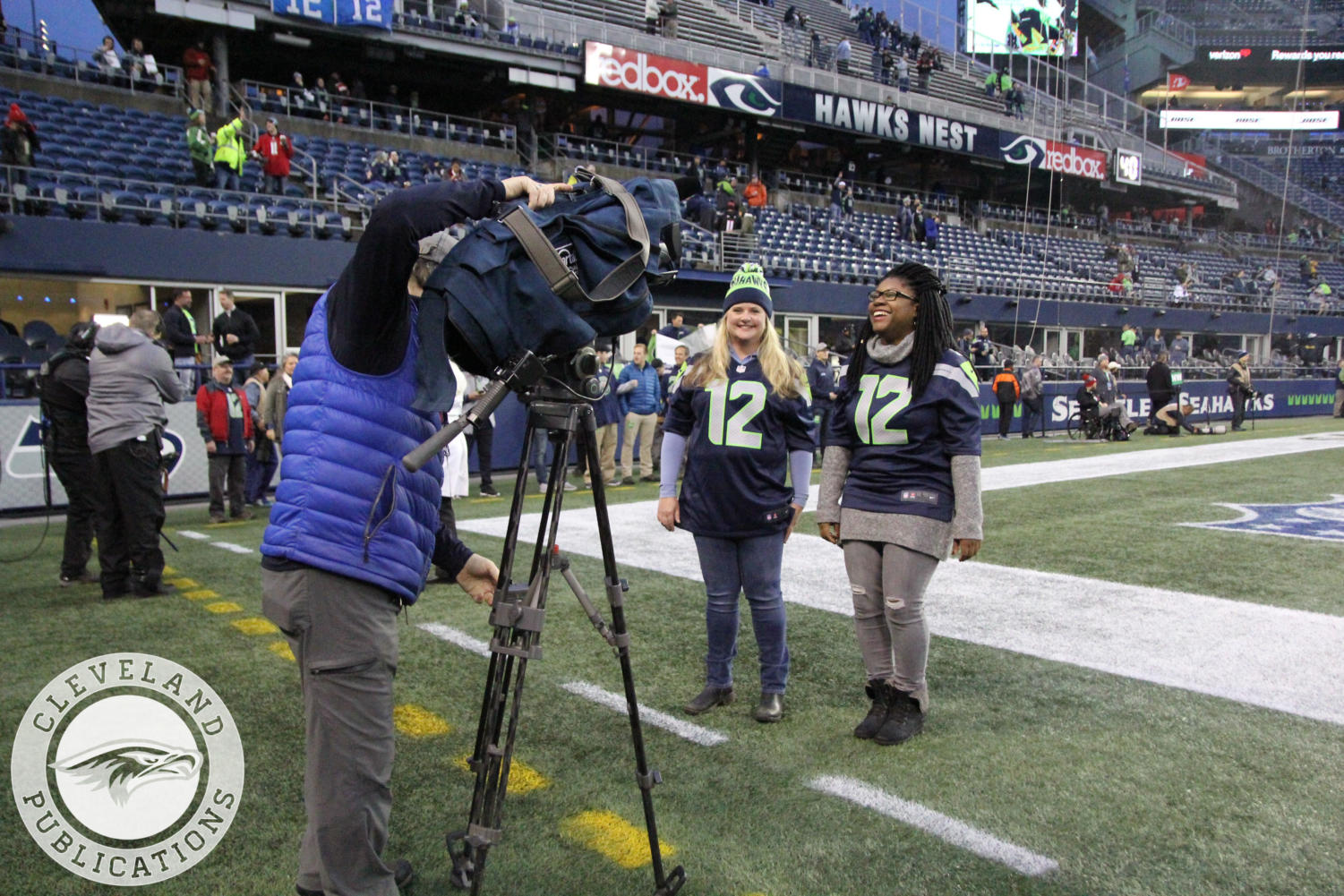 Media teacher Teresa Scribner, right, and Jessica Torvik, a teacher from Nathan Hale, film their introductions to be played during the Seahwaks' game against the Atlanta Falcons on Nov.20. Both Scribner and Torvik were selected as
