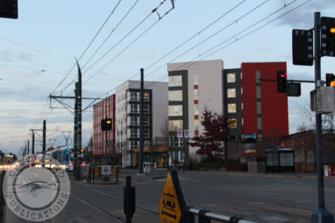 The light rail zips past new apartment buildings in Othello on Nov. 17. The Othello Plaza was one of the first areas to see a change in demographics after the light rail was installed. Property values in the neighborhood have drastically increased since 2009.