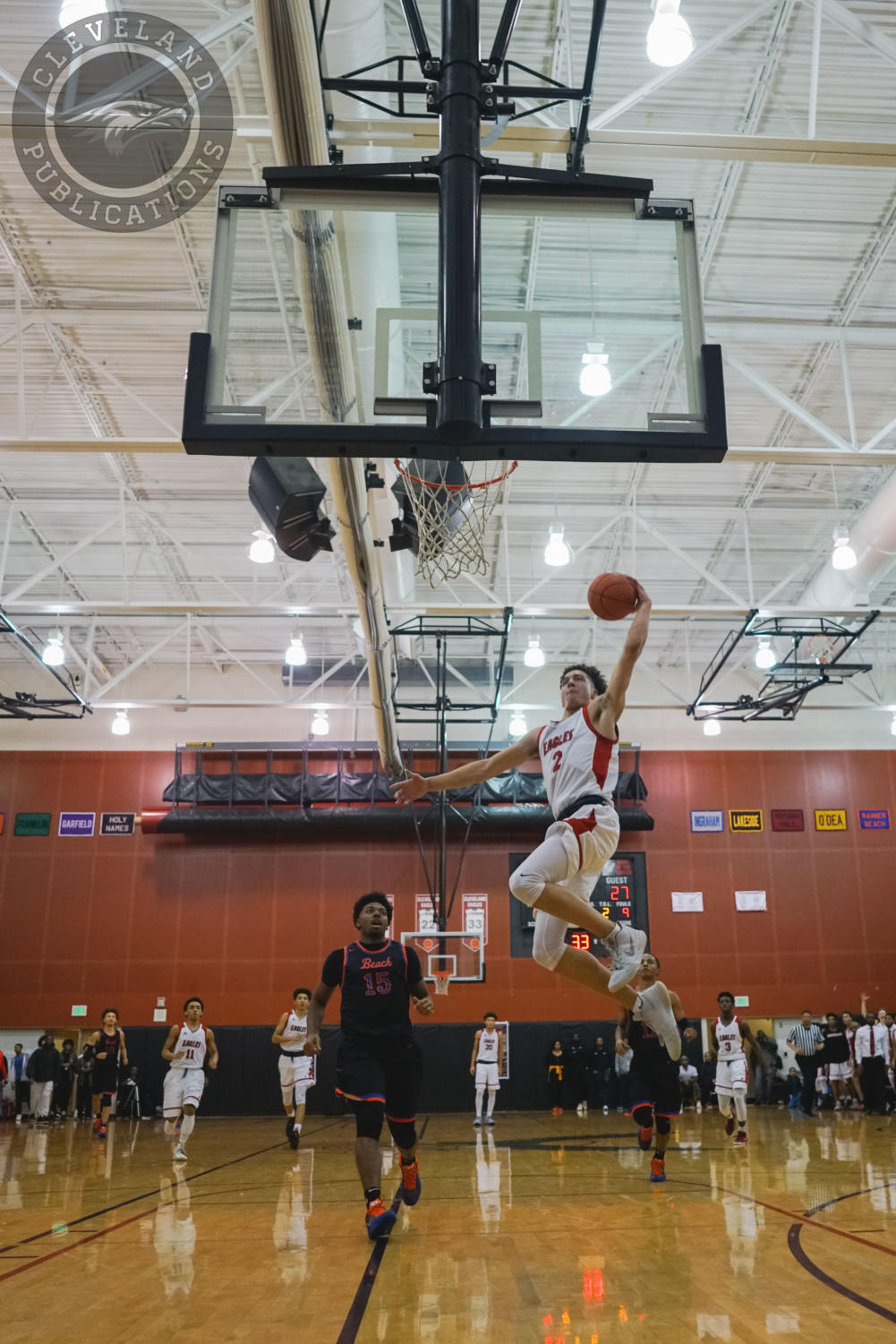 "Senior Charles ""C.J."" Elleby goes up for a dunk on Senior Night against South end rival Rainier Beach on Feb. 2. Coach Jerry Petty announced Elleby and Jahleel Breland would have their jerseys retired at the end of the season."