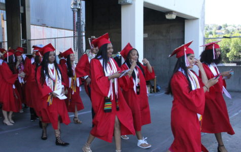 Students from the class of 2017 make their way from the Memorial Stadium Concourse to the field on June 21, 2017. The class graduation rate of 92 percent.