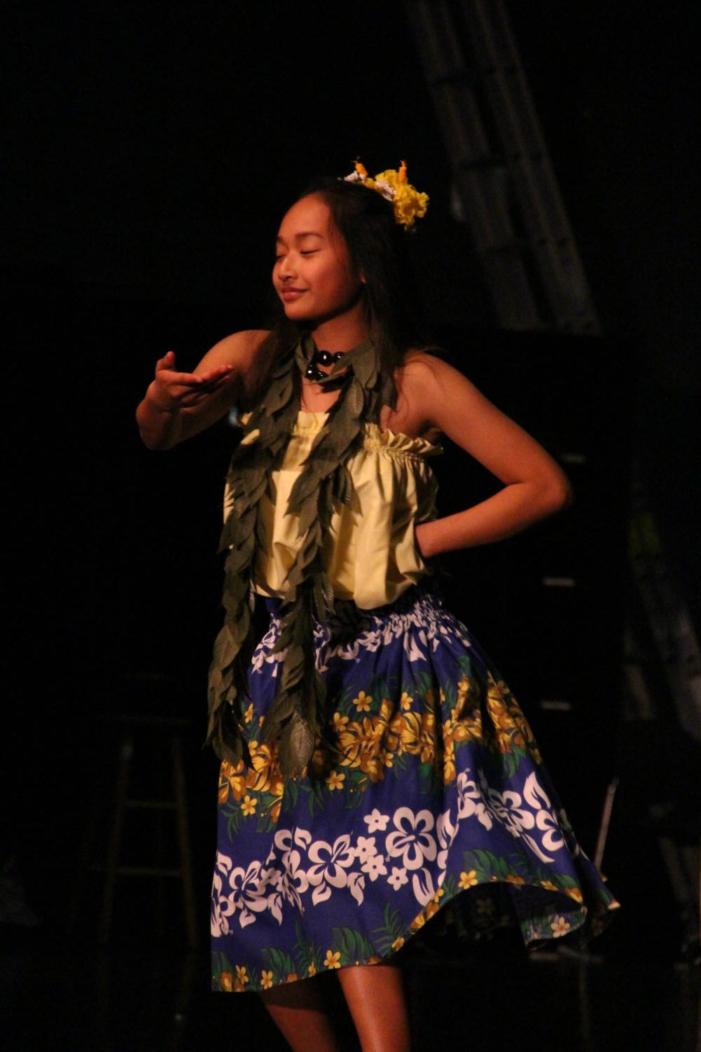 Sophomore Gabriella Payoyo performs a traditional Polynesian hula at Cleveland's Multicultural Night on March 9.