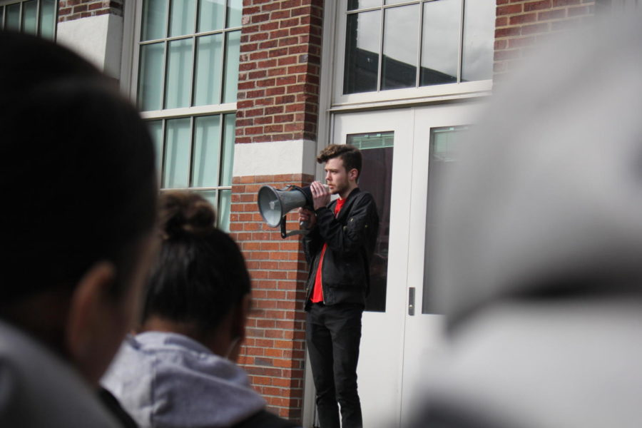 Senior Jay Kent makes a statement to the group of students participating in the walkout on March 14.