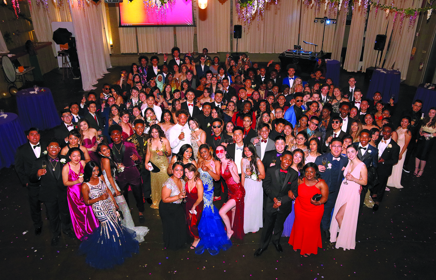 "The Class of 2018 gathers on the dance  oor for a group photo at their fairytale-themed prom, ""Happily Ever After,"" on May 12, at 415 Westlake."