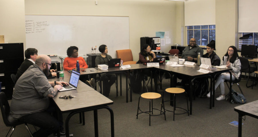 Cleveland's Building Leadership Team discuss an upcoming schedule change on Dec. 4. Members are Bryan Gordon, left, Catherine Brown, Teresa Scribner, Paige Wakamatsu Wilson, Napsiyah Sallee, Evin Shinn, Andrew Cornel and Jessica Truong. Not pictured are Logan Reichert and Megan Claus.
