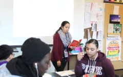 """Sophomore Humanities teacher Ana-Claudia Magaña reads """"Things Fall Apart"""" to her students on Nov. 30. Magaña said recent shootings in places of worship have made it harder for her to feel safe when she attends church, but she tries not to focus on the negative."""