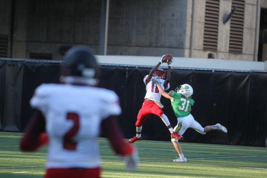 Senior Martrez Darden makes a catch over Roosevelt's Nate Link on Sept. 28. The Eagles came up short 42-26. The football team had only one win this season against Sammamish.