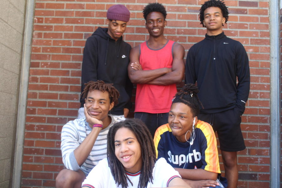 Clockwise from top right, Calvin Law Jr., King Nisby,  Isaiah BanksAvery Brown, Sincere Harris and Jordan Cannon are caught off guard during their photo shoot on May 9. The boys have all spent years combatting stereotypes surrounding their hair.