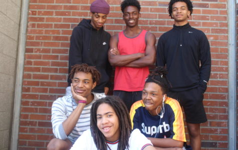 Clockwise from top right, Calvin Law Jr., King Nisby, Isaiah Banks, Avery Brown, Sincere Harris and Jordan Cannon are caught off guard during their photo shoot on May 9. The boys have all spent years combatting stereotypes surrounding their hair.