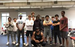 Career Choices teacher Lenny Haynes, front, poses with his group of trainees after a morning workout. Haynes has been working with students and athletes who want to get in shape or improve in their sport